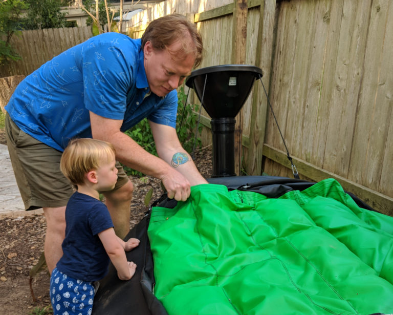 Caleb Crow and son assembling Home BioGas 2.0
